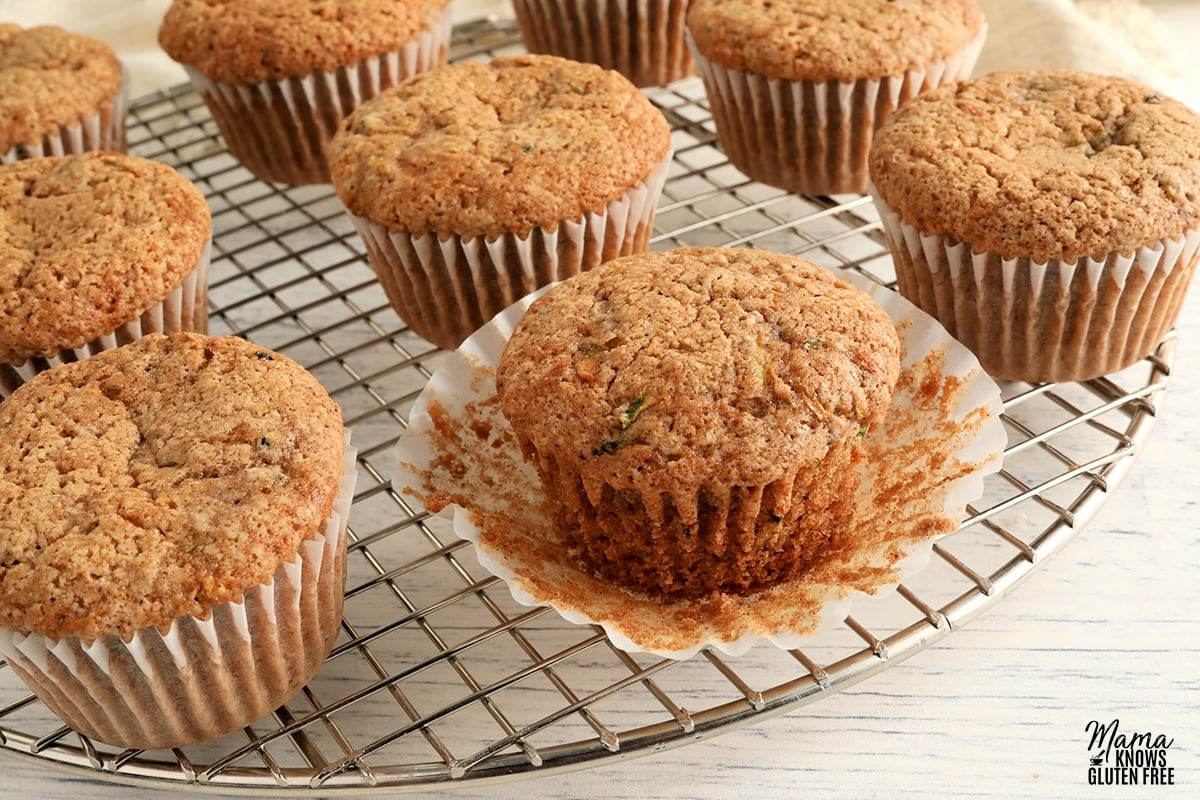 gluten-free zucchini muffins on a sliver cooling rack