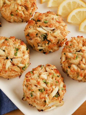gluten-free crab cakes cakes on a white platter with lemon slices
