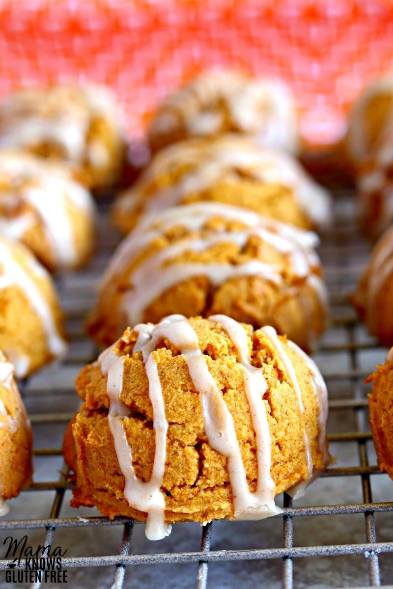 gluten-free pumpkin cookies with icing on a cooling rack