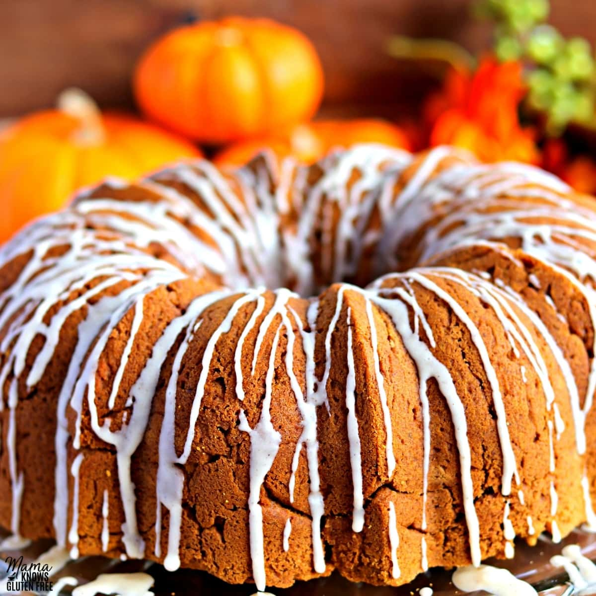 gluten-free pumpkin cake with pumpkins in the background
