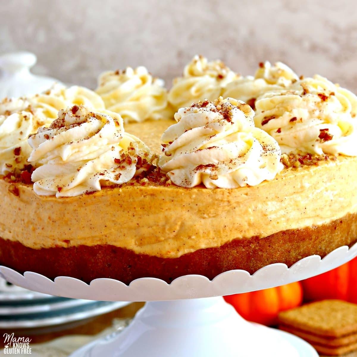 gluten-free pumpkin cheese cake on a white cake stand
